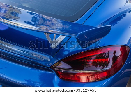 Close-up view of blue sports car on display - stock photo