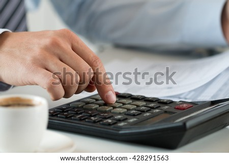 Close up view of bookkeeper or financial inspector hands making report, calculating or checking balance. Home finances, investment, economy, saving money or insurance concept - stock photo