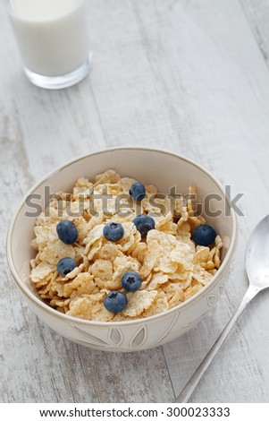 close up view of bowl full of muesli on color back - stock photo