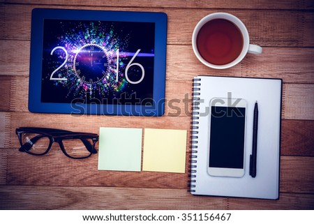 Close up view of business stuff against new year countdown graphic - stock photo