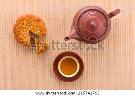 Close up view of Chinese moon cake with tea for celebrate in Mid autumn festival. Above angle - stock photo