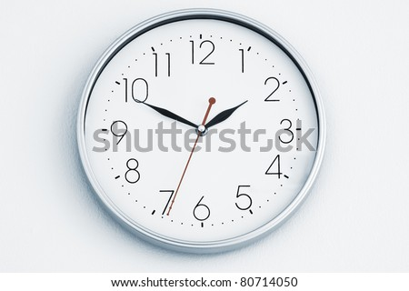 Close up view of clock-face  on white back. - stock photo