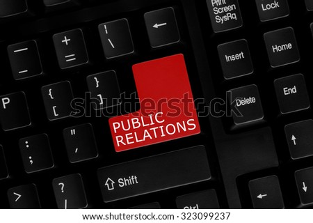 Close-up view of computer keyboard with Public Relations words on keyboard button. - stock photo