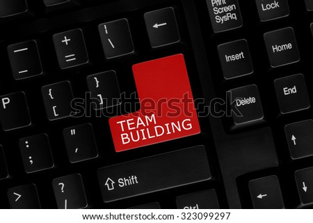 Close-up view of computer keyboard with Team Building words on keyboard button. - stock photo