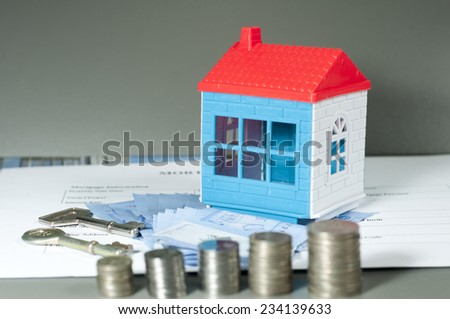 Close up view of concept of saving money for home - stock photo