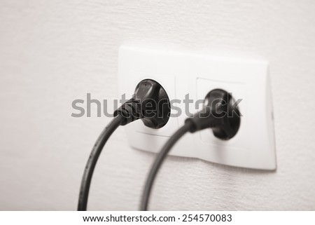 Close-up view of electric outlets with power cables - stock photo