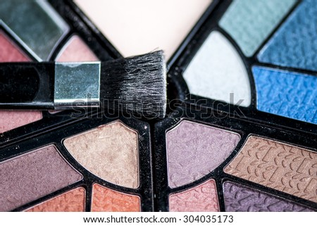 Close-up view of eye shadow and brush cosmetics, shallow DOF - stock photo