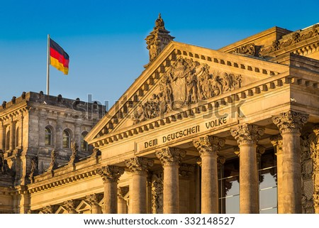 Close-up view of famous Reichstag building, seat of the German Parliament (Deutscher Bundestag), in beautiful golden evening light at sunset, Berlin Mitte district, Germany - stock photo