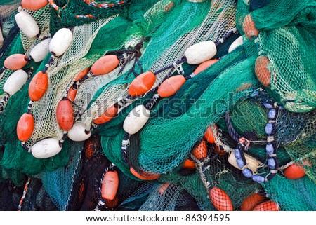 Close up view of fishing net. Marine background. - stock photo