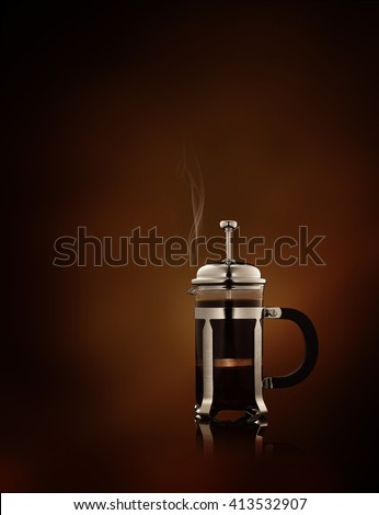 close up view of  french-press filled with fresh black coffee   on brown background - stock photo