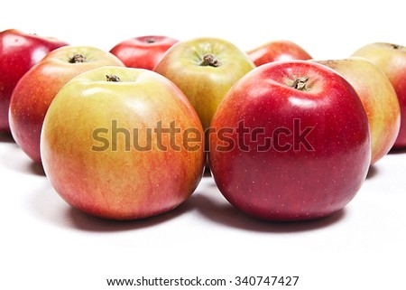 Close up view of group of red apples. Group of juicy ripe fruits.  Isolated on white background.