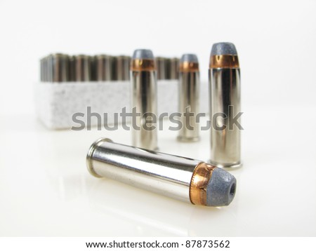 Close up view of hollow point bullet with shallow dof - stock photo