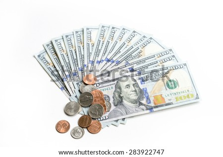 Close-up view of hundred dollars banknote and coins on white background. Copy space. - stock photo