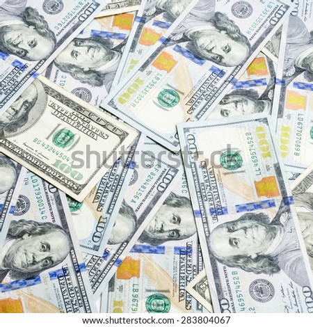 Close-up view of hundred dollars banknote, old and new dollar bills. - stock photo