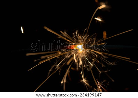 Close-up view of lit up holiday sparkler  - stock photo