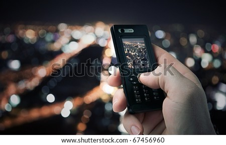 close up view of  mobile phone taking picture on color back - stock photo