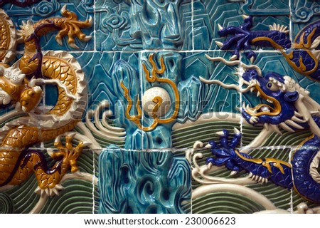 Close up view of modern art on tiles - stock photo