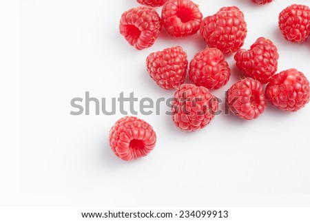 close up view of nice fresh raspberry on white back - stock photo