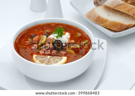 close up view of nice yummy red russian soup on white back - stock photo