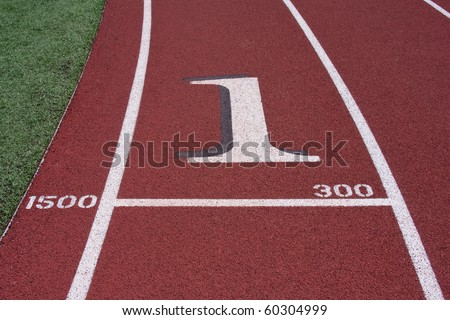 Close up view of number one on track lane. - stock photo