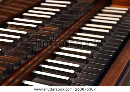 Close-up view of old harpsichord keys - stock photo