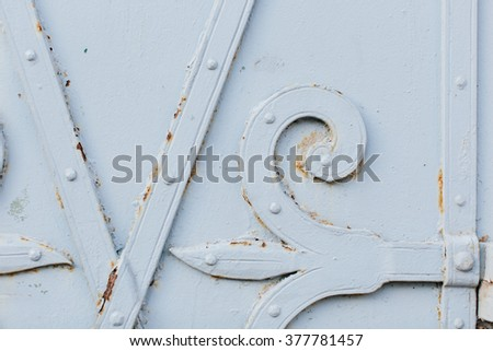 Close up view of old painted white gate with bits of rust showing through for rustic background - stock photo