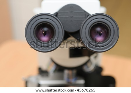 close-up view of optical microscope for educational and routine use - stock photo
