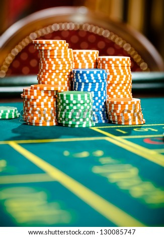 Close up view of piles of chips on the roulette table. Symbol of addiction to the gambling - stock photo