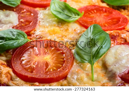 Close up view of pizza Margarita with tomatoes and basil - stock photo