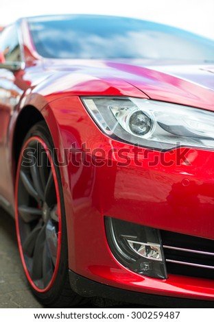 Close-up view of red sports car headlight. - stock photo