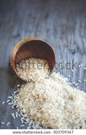 Close-up view of rice bowl on rustic wooden table, shallow DOF - stock photo