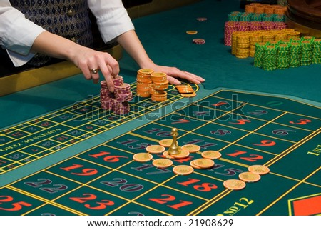 Close up view of roulette gambling chips on the table - stock photo
