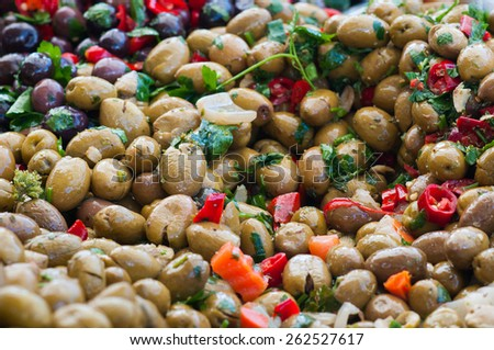 Close up view of seasoned green olives in a weekly sicilian market - stock photo