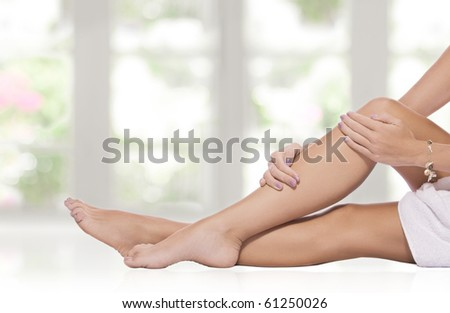 close up view of smooth woman�s legs on color  background - stock photo