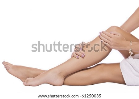 close up view of smooth woman�s legs on white background - stock photo