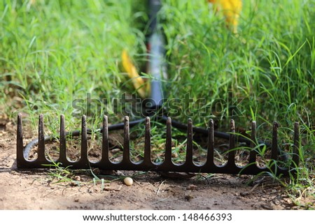 Close up view of someone using a bow rake  - stock photo