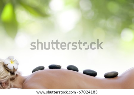 close up view of spa procedure on color  back - stock photo