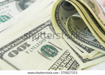 Close-up view of stack of US dollars - stock photo