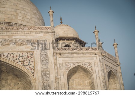 Close up view of Taj Mahal from East side. Post-processed with grain, texture and colour effect. - stock photo