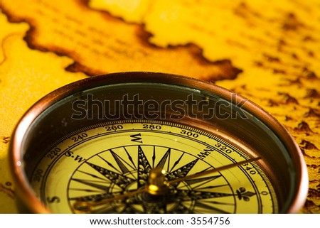 Close-up view of the compass on old map - stock photo