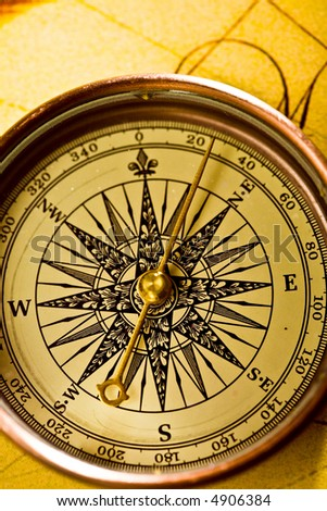 Close up view of the compass on old map - stock photo