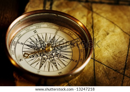 Close up view of the Compass on the old paper background - stock photo