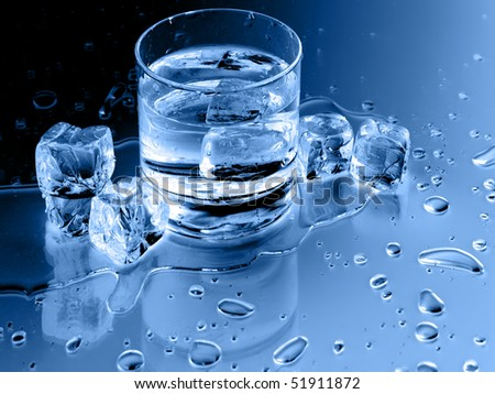 Close up view of the glass and ice cubes on black - stock photo