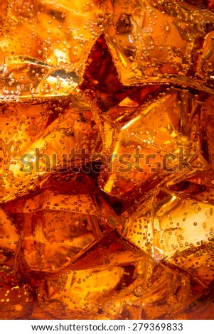 Close up view of the ice cubes in cola background - stock photo