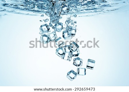 Close up view of the ice cubes in water - stock photo