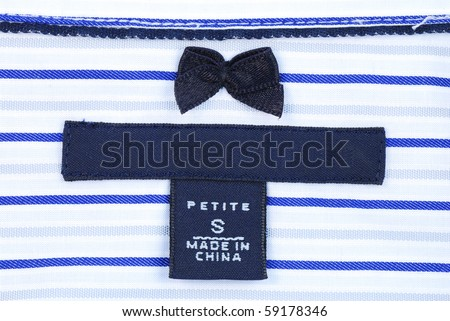 Close up view of the Petite-size clothing label - stock photo