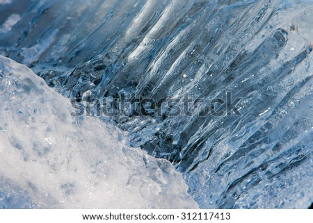Close-up view of translucent iceberg. South coast of Iceland. - stock photo