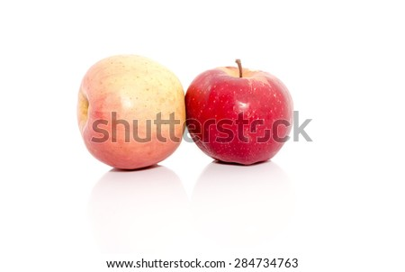 Close up view of two red apples isolated on a white background. - stock photo