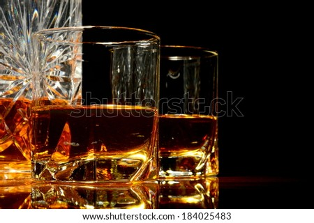 Close-up view of whiskey in a carafe and two glasses - stock photo