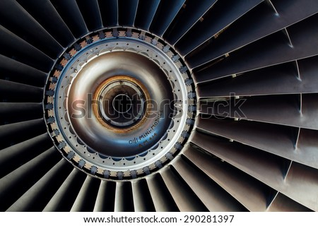 Close up view on a part of old plane turbine with text and registration mark - stock photo